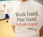 T-shirt that reads: Work hard. Play hard. Rehab hard. UW Health Sports Medicine