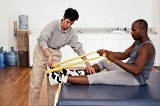 Physical therapist working on patients' ankle