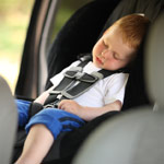 Kid asleep in a car seat
