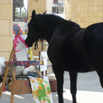 Rhia the horse painting a picture
