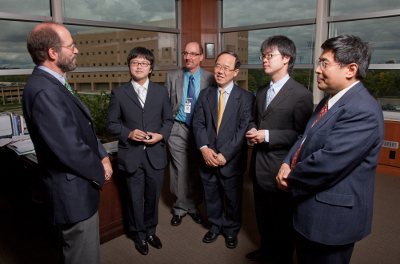 Dr. Robert Golden (left), Dean of the University of Wisconsin School of Medicine and Public Health, and Dr. Ron Magness (third from left), director of division of reproductive sciences in the UW SMPH Department of Obstetrics and Gynecology, talk with members of the Hamamatsu University School of Medicine in Japan. Their guests were, from left, Dr. Kenta Kawai, resident; Dr. Naohiro Kanayama, department director; Dr. Yoshimasa Horikoshi, resident; and Dr. Hiroaki Itoh, associate professor and vice chair. All four doctors are in Hamamatsu's Department of Obstetrics and Gynecology.