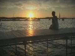 Woman sitting on dock overlooking Lake Mendota