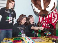 Bucky assists the volunteer callers during Bucky Bingo at American Family Children's Hospital