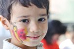 Boy with facepaint; Reducing Screen Time Can Help Kids Lose Weight