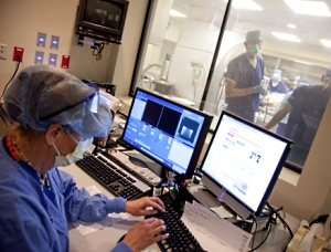 With Dr. Sillay in the operating room, staff refer to the iMRI guided imagery.
