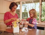 Pediatric Fitness Clinic: Mother and child cooking together