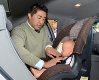 WISC-TV news anchor Andy Choi during the Kohl's Celebrity Car Seat Challenge