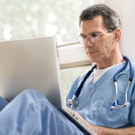 doctor using a laptop; University of Wisconsin Hospital and Clinics named to Most Wired list