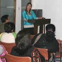 Dr. Burkat providing educational instruction to colleagues in Delhi, India.