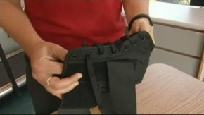 Dr. Alison Brooks demonstrates the proper way to secure an ankle brace