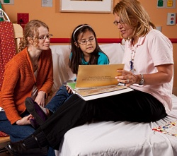 American Family Children's Hospital: nurse, patient and Child Life therapist is patient room