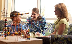 American Family Children's Hospital careers: Nurse with mother and child
