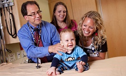 American Family Children's Hospital careers: Doctor and nurse with child and mother