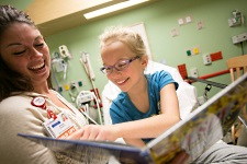 Child Life at American Family Children's Hospital: Child Life therapist with young patient