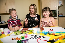 Child Life at American Family Children's Hospital: Child Life therapist with two children painting