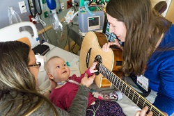 American Family Children's Hospital music therapist Samantha Sinai with a young patient.