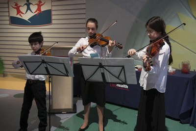 A trio of young musicians, all children of UW Health providers, provided holiday music for the reception.