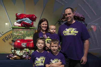 The Koch family with the blankets donated to patients at American Family Children's Hospital.