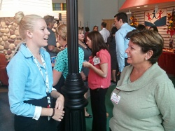 Two Children's Hospital employees talk during the reception.