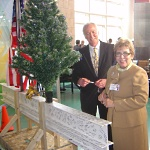 Rich Lynch and Donna Katen-Bahensky sign the topping off tree.