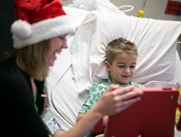 Virtual Santa with young patient at American Family Children's Hospital