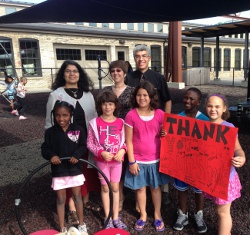 UW Health doctors Nancy Pandhi, Aleksandra Zgierska and David Rabago with some kids under the new shade sails at Goodman Community Center.