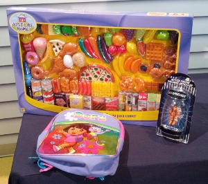 Some toys featured in the Trouble in Toyland report: Play food, a Morphobot action figure and a backpack that contain phthalates.