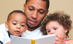 American Family Children's Hospital books about diabetes: Father reading to kids