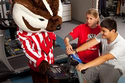 Pediatric Fitness Clinic: Boy exercising with instructor and Bucky Badger