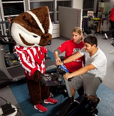 UW Health Pediatric Fitness Clinic: Bucky Badger with kid exercising and instructor