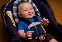 American Family Children's Hospital Safety Center car seat recycle day: Child in car seat