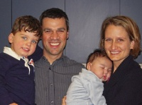 Kelly with her husband and two sons in 2011