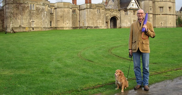 Lynn Scheid and his dog visiting a castle in the UK