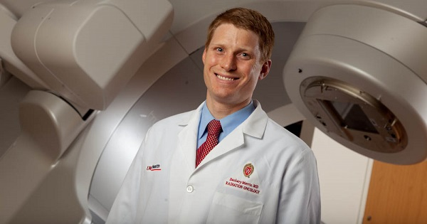 UW Carbone Cancer Center researcher and radiation oncologist Dr. Zachary Morris is looking at ways to combine radiation therapy and immunotherapy to teach the immune system to fight cancer.