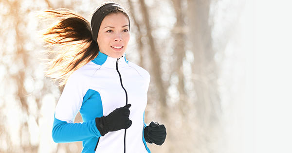 Woman running in winter; Winter training can be challenging for runners, but with planning it's possible to keep going no matter the season.