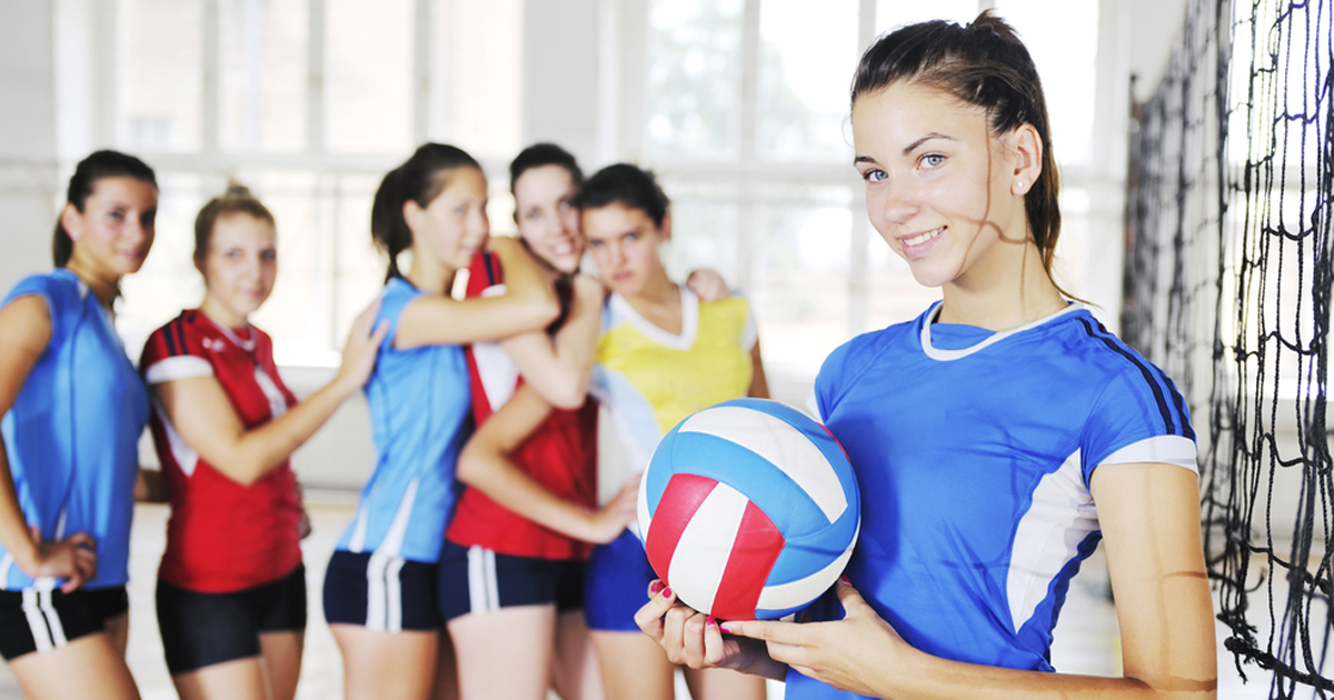 Teen girls playing volleyball; UW Health Sport Psychologist Shilagh Mirgain helps teens develop their mental game to excel on the field