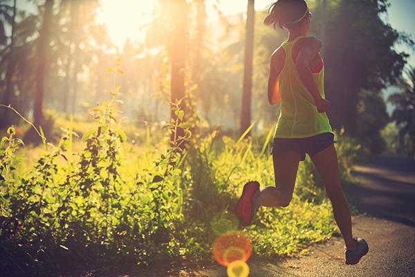 woman running in the summer heat