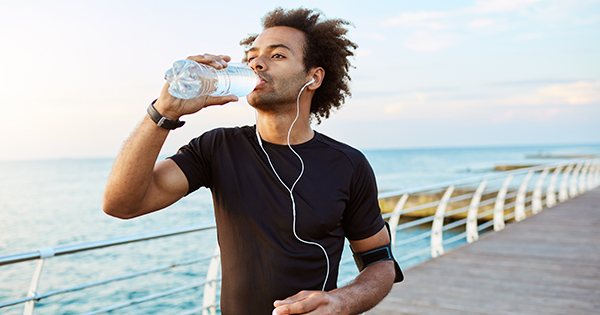 Man drinking water; UW Health Sports Medicine experts explain how dehydration affects athletic performance