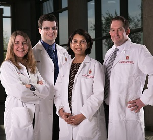 Josephine Harter, MD, Paul Weisman, MD, Aparna Mahajan, MD and Christopher Flynn, MD, PhD, represent 4 out of 24 surgical pathology faculty in the UW Department of Pathology and Laboratory Medicine.