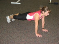 Plank with knees to chest starting position