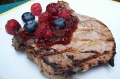 Cola Marinated Pork Chops with Raspberry Wine Sauce