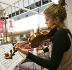 Volunteer musicians perform in public areas of University Hospital and American Family Children's Hospital.