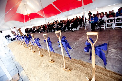 Eleven shovels are ready for the groundbreaking ceremony, which drew a large crowd despite adverse weather conditions.