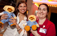 American Family Children's Hospital Child Life Specialists Megan Wing and Regina Yocum show off the Chemo Ducks.