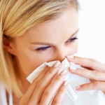 Woman sneezing, Tips for Managing Your Seasonal Allergies