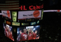 Jill Roach and her daughter on the Kohl's Center Scoreboard