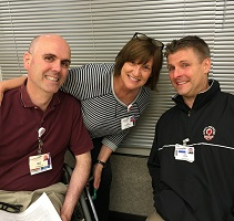 Jackie, pictured center, with UW Health exercise physiologists and Fitness Center staff Dan Wanta (left) and Jude Sullivan (right)