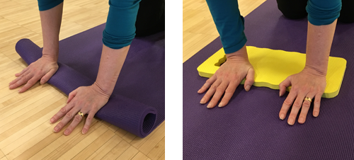 Roll your mat or use a foam pad to relieve wrist pain