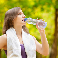 Woman Runner Hydrating
