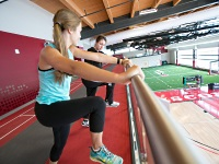 UW Health Sports Performance Preseason Cross Country training: Woman working on running form with a trainer
